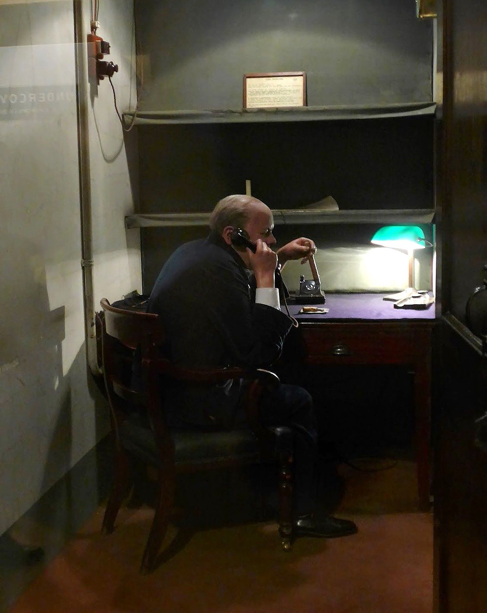 """A faux Churchill in the secret transatlantic telephone room disguised as an """"occupied"""" toilet."""