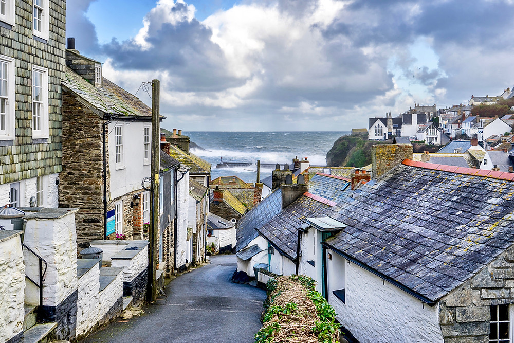 tiny streets of Port Isaac with the Atlantic Ocean crashing in the background