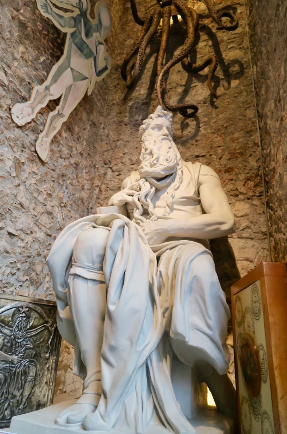 Moses with an octopus over his head, after Michelangelo's statue