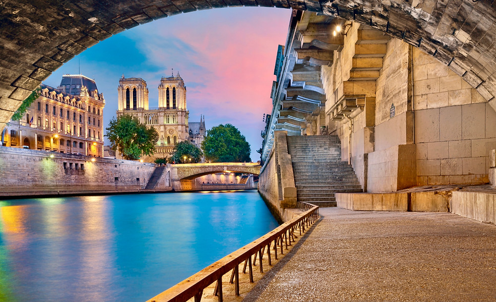 view of Notre Dame from the banks of the Seine River