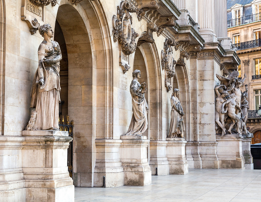 statues and busts of musicians on the facade of the Opera Garnier