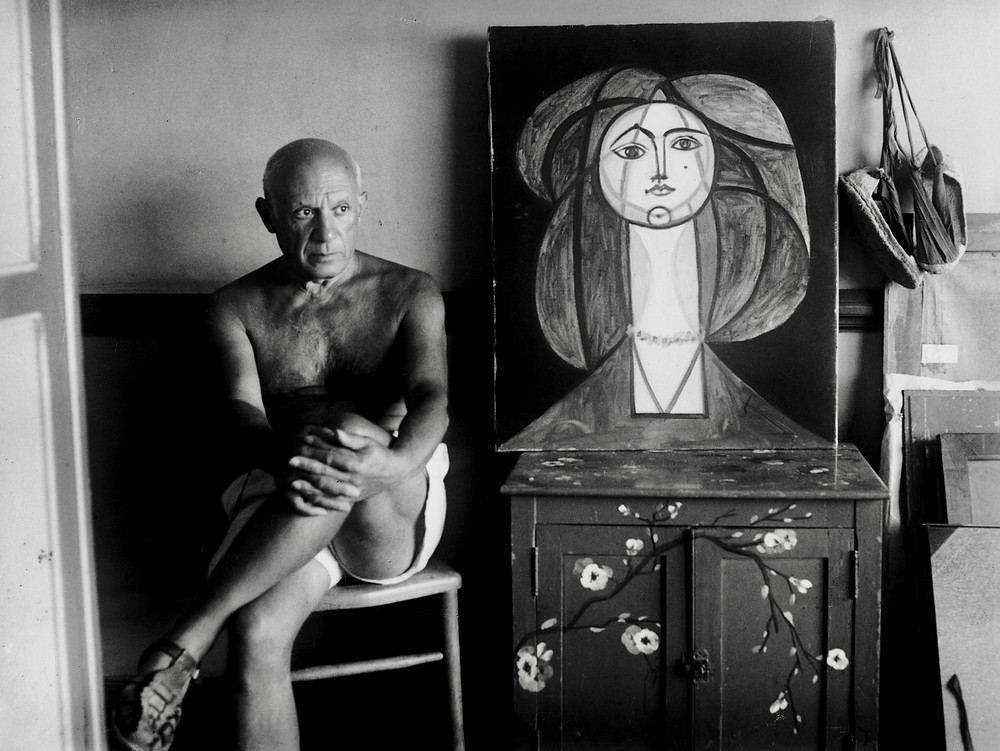 Picasso with a portrait of his lover Francoise