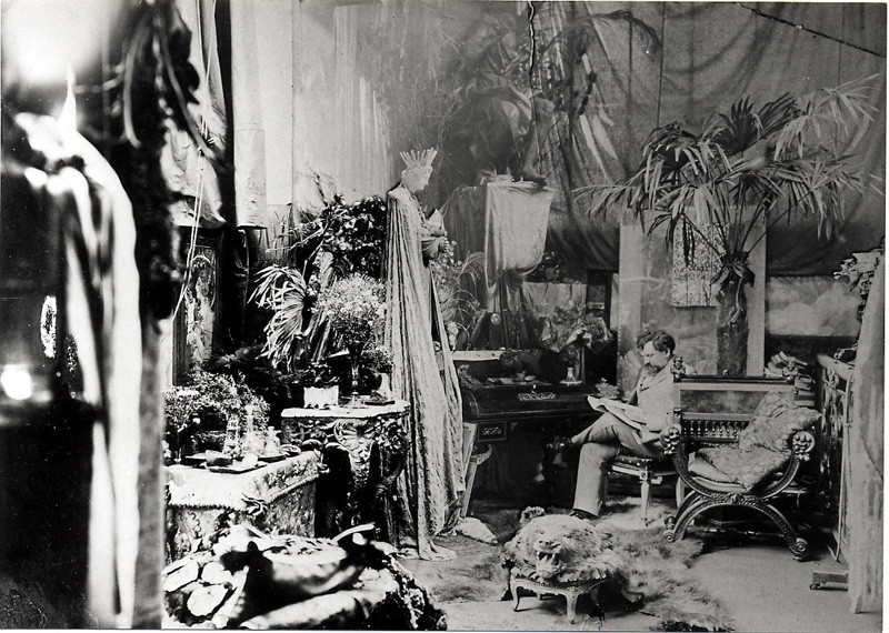 This is the messy Parisian studio of artist Alphonse Mucha, a pioneer of a little movement called Art Nouveau, which influenced Claudel