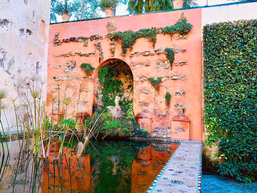 a grotto in the gorgeous gardens of the Royal Alcazar -- a rare quiet moment in Seville