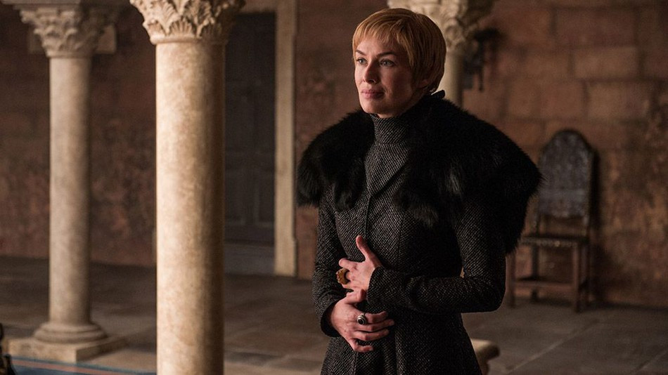 Cersei clutches her stomach convincing Tyrion that she's pregnant