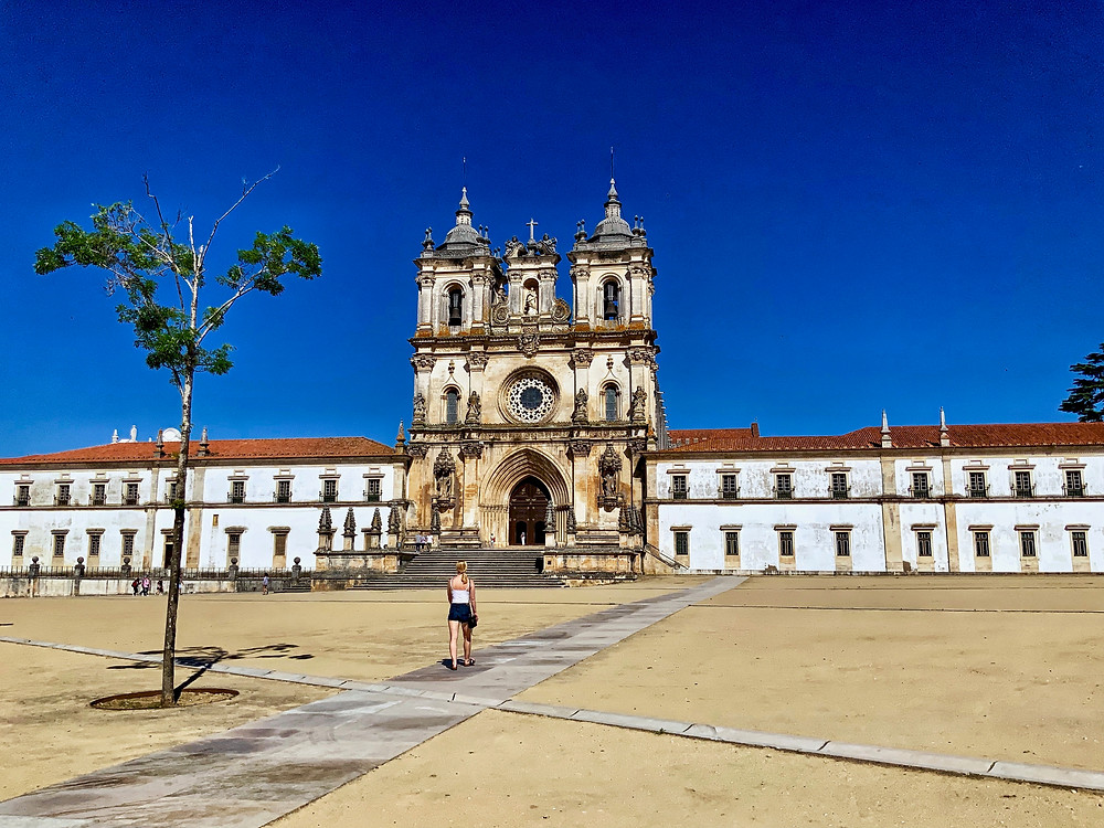 the imposing entrance of the Alcobaça Monastery