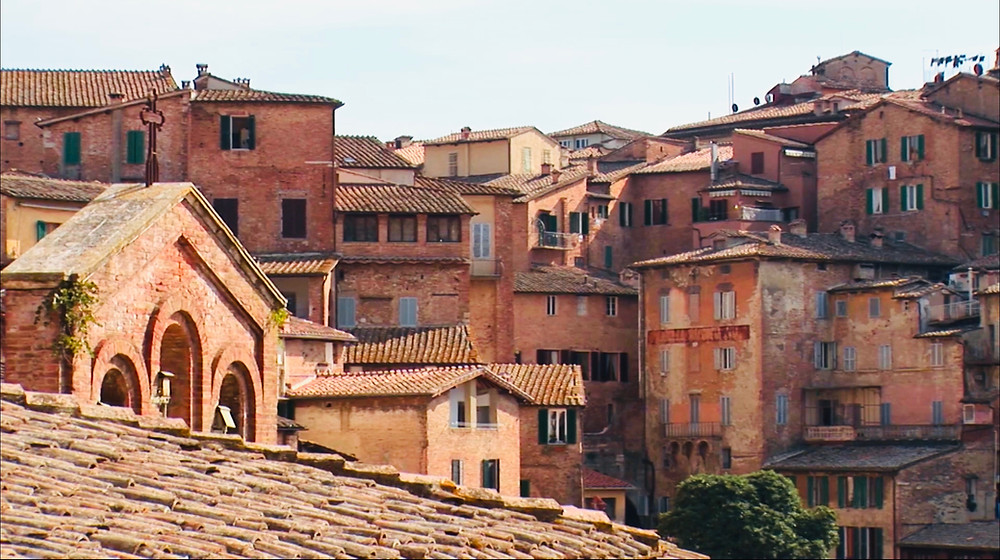beautiful rustic sienna-colored homes in Siena Italy