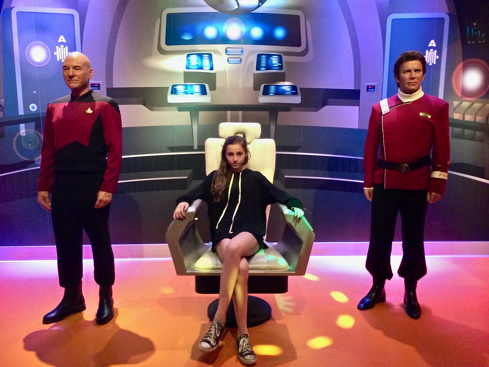 Gillian posing with wax Star Trek captains in LA