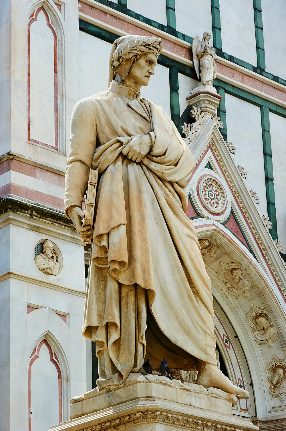 Dante statue in front of the Basilica of Santa Croce in Florence Italy