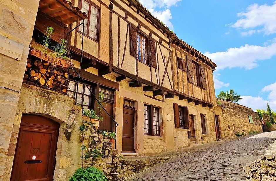 sandstone houses on a street in Cordes sur Ciel France