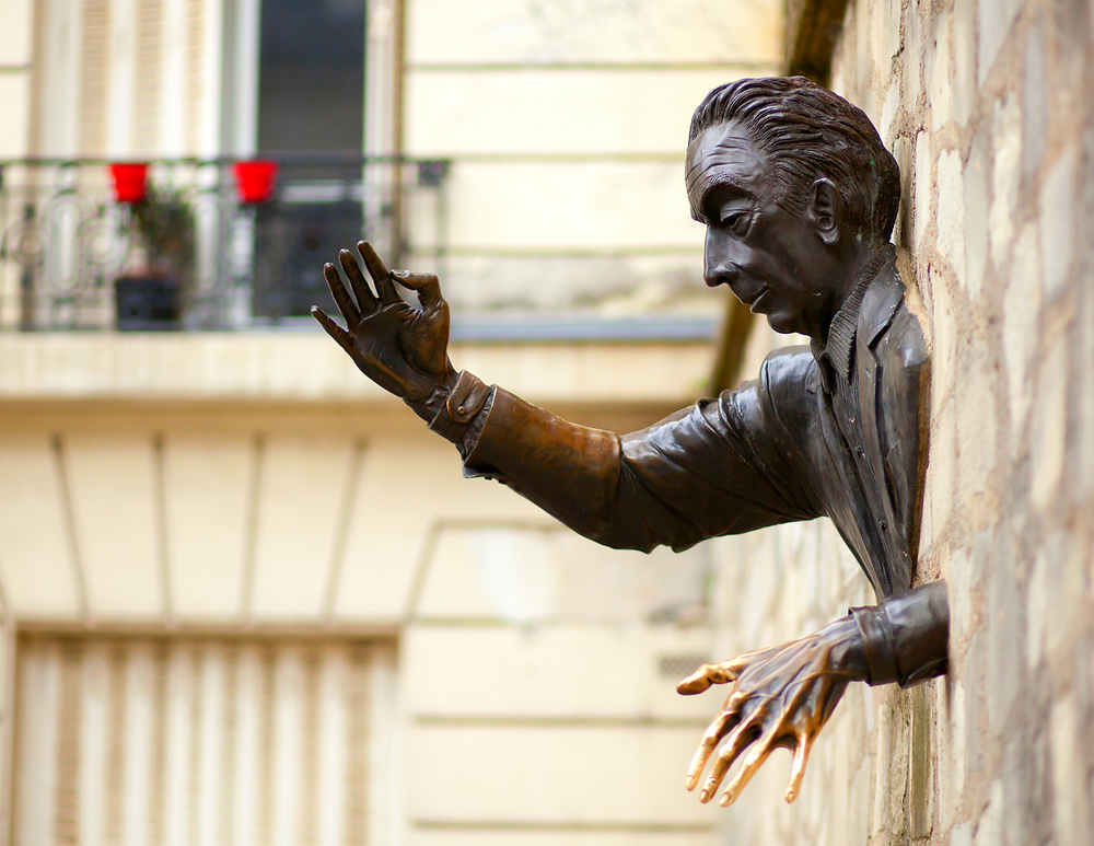 sculpture of The Man Who Could Walk Through Walls in Montmartre