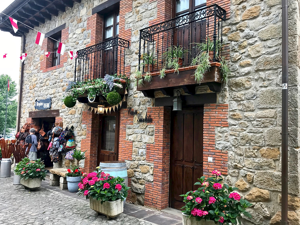 wrought iron balconies and flower pots in medieval Santillana del Mar