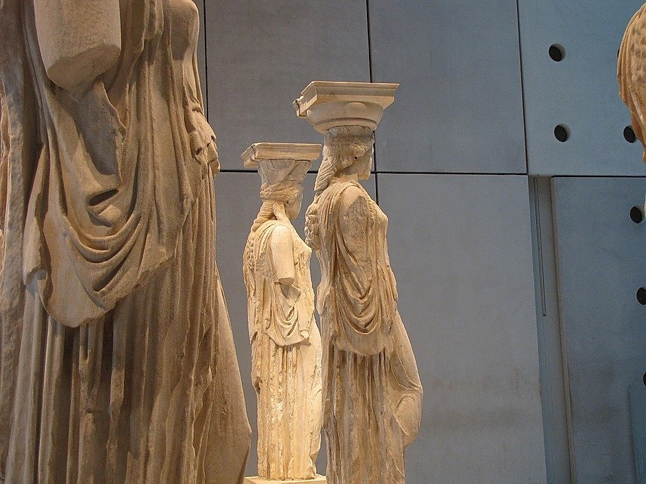 the original Caryatids from the Erechtheion, on display in the Acropolis Museum
