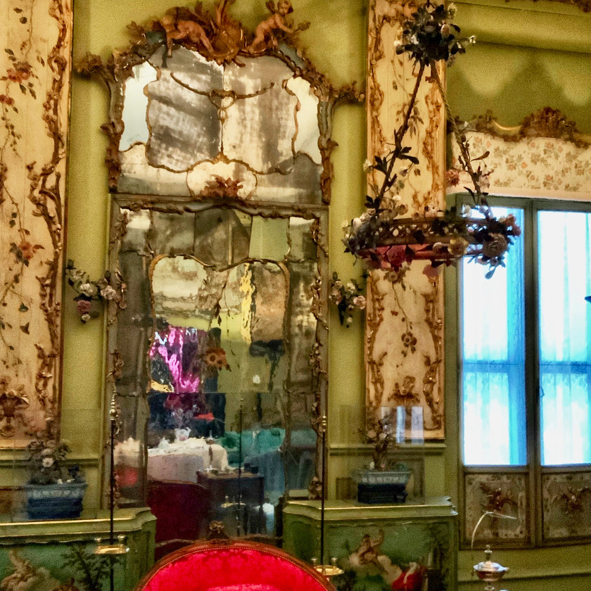 a Venetian mirror and light in the Isabella Stewart Gardner Museum