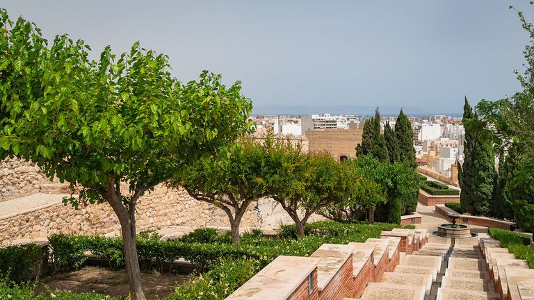 The Alcazaba gardens with flower filled terraces and ponds