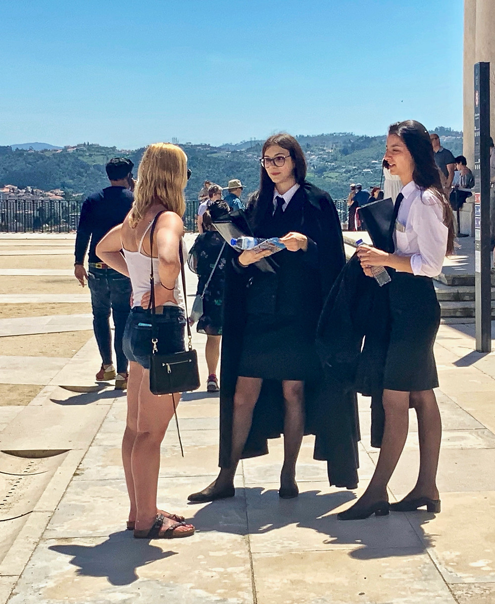 my daughter chatting with some black caped Coimbra students