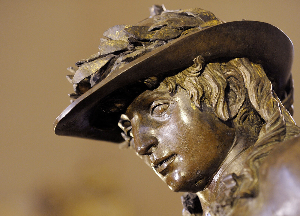 detail of David where you can see the gilding in his hair and hat