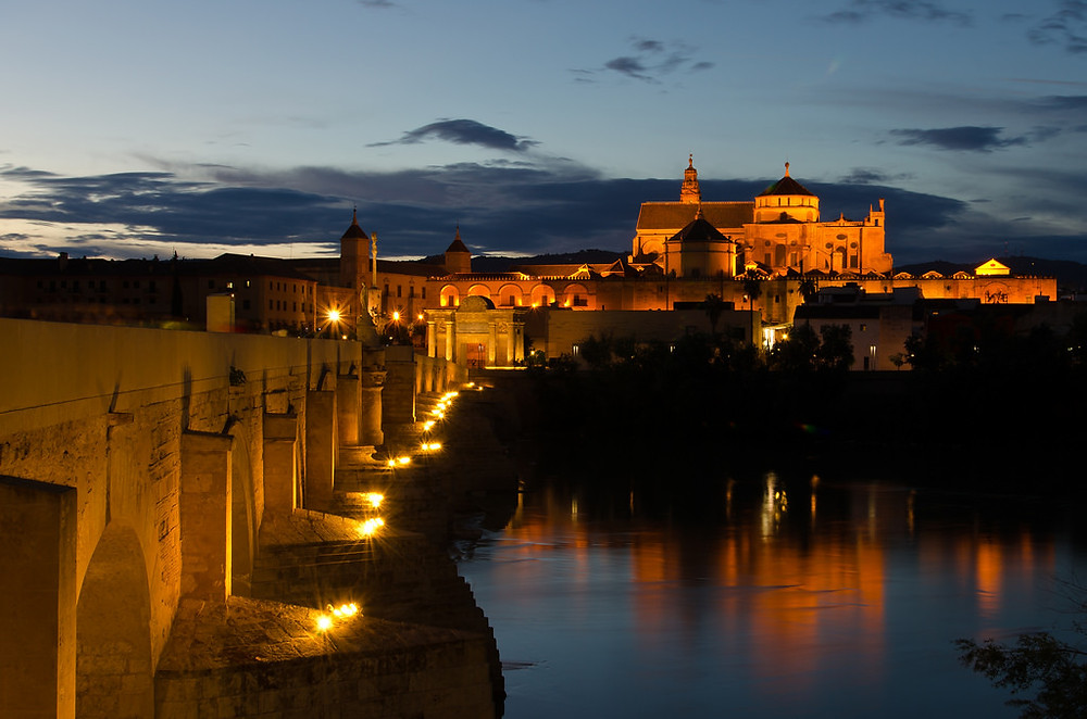 the Roman Bridge of Cordoba Spain lit up at night