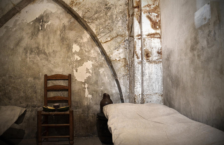 a grim prison cell in the Conciergerie