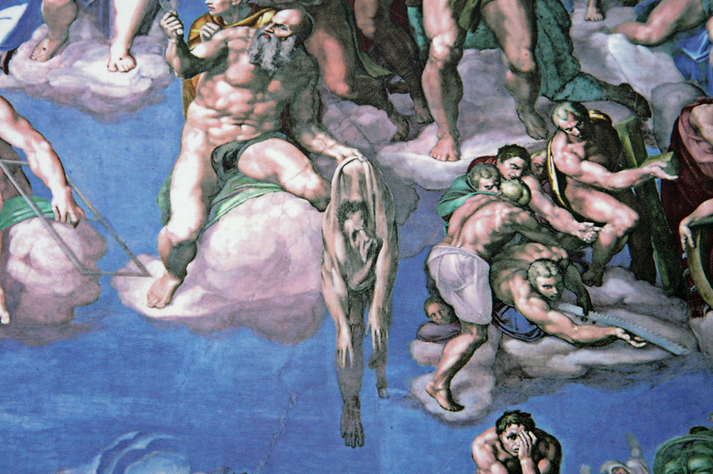 Michelangelo's face face is on the shedded serpent skin held by Saint Bartholomew.
