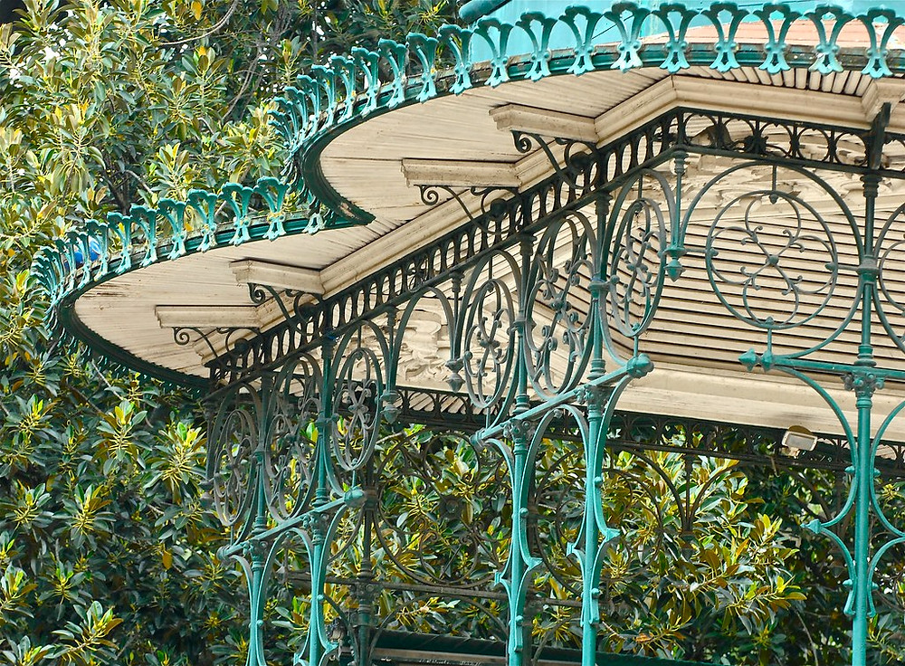 detail of beautiful wrought iron bandstand in the Estrela Garden