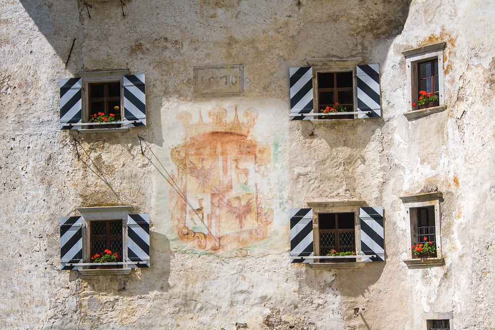 the windows and coat of arms on Predjama Castle