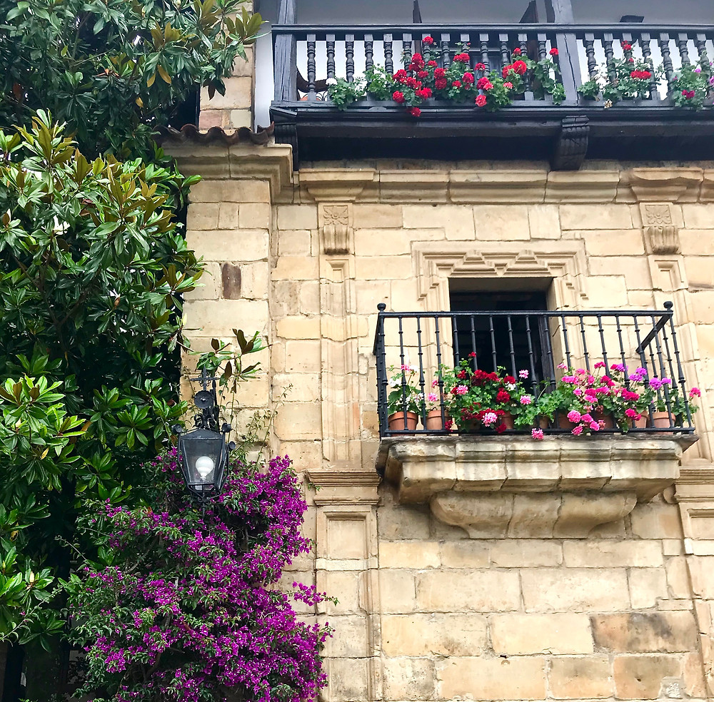 colorful window boxes in Santillana del Mar