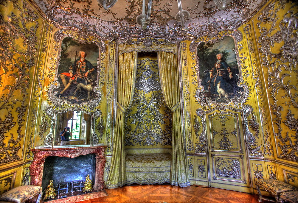 The lemon yellow and silver bedroom at Amalienburg -- look at the short little bed. The portraits flanking the bed are of Amalia and Karl.