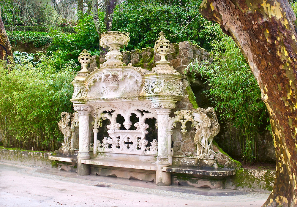 an ornate bench between the palace and the chapel