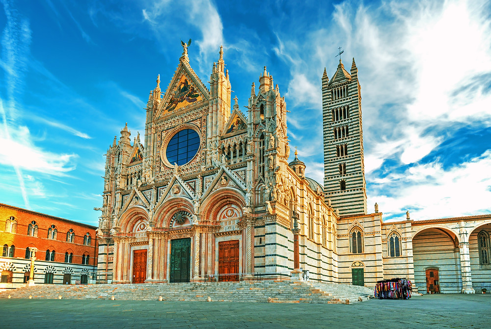 the beautiful Siena Cathedral, clad in alternating stripes of white and dark green marble
