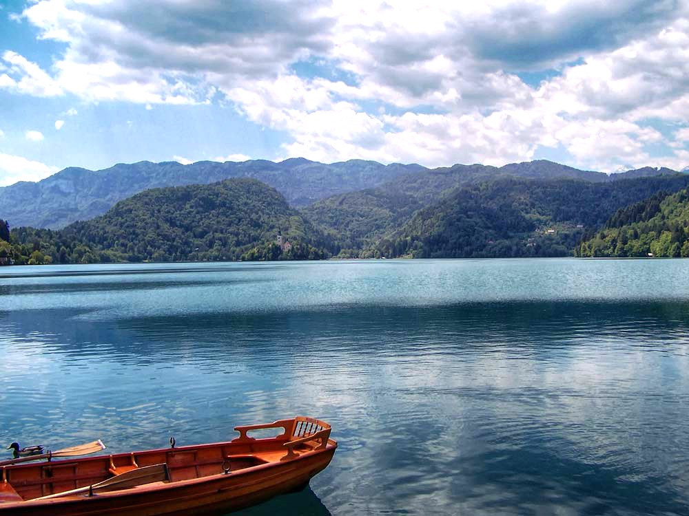 a wooden row boat on Lake Bled