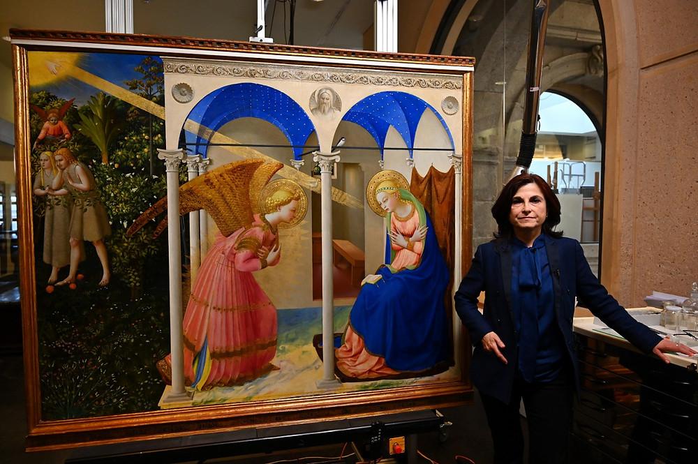 Almudena Sanchez, Prado restorer poses next to the restored Annunciation (AFP/Gabriel Bouys)