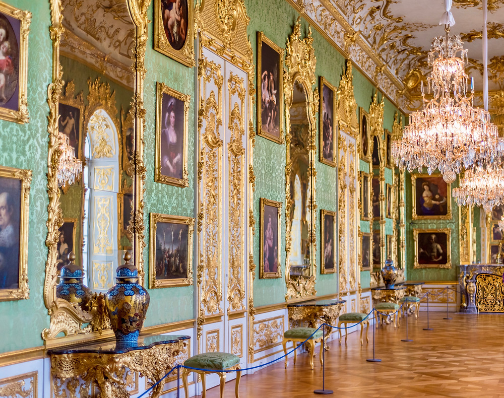 a ceremonial room in the Munich Residenz with portraits of the royal family and copies of the old masters