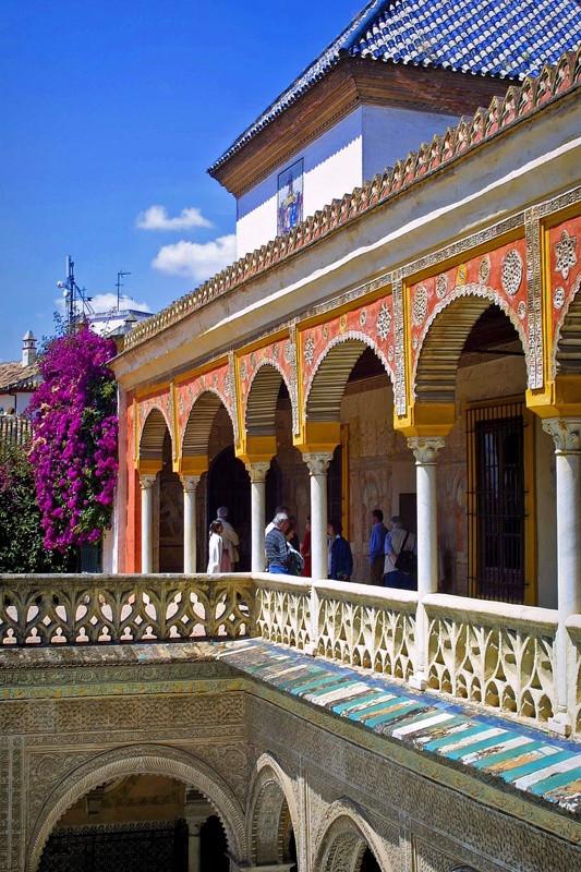 painted Renaissance arches on the upper floor of the Casa de Pilatos