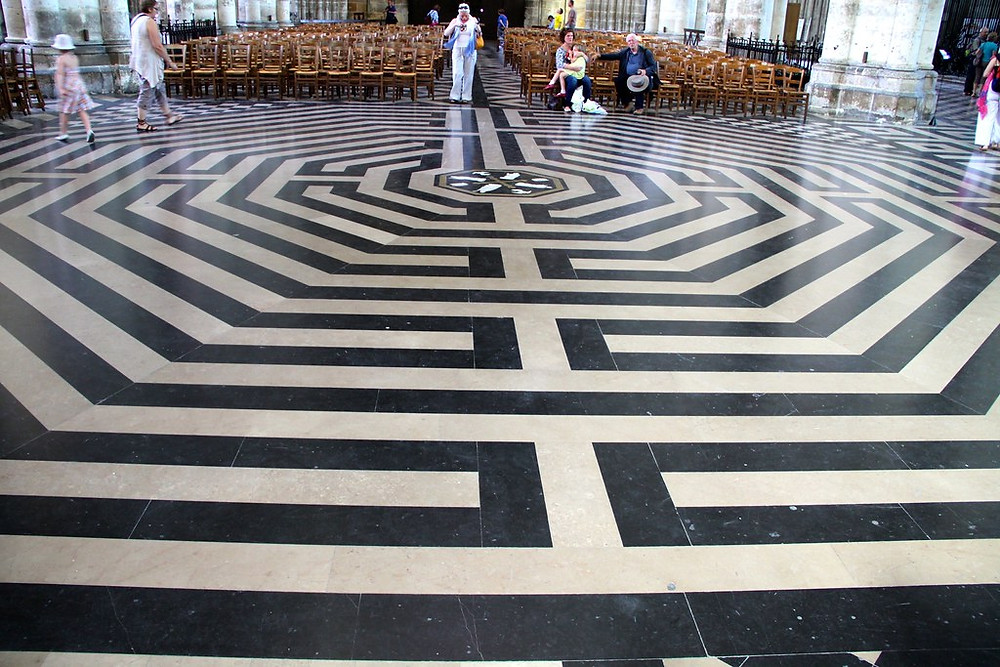 the black and white stone labyrinth of Amiens Cathedral