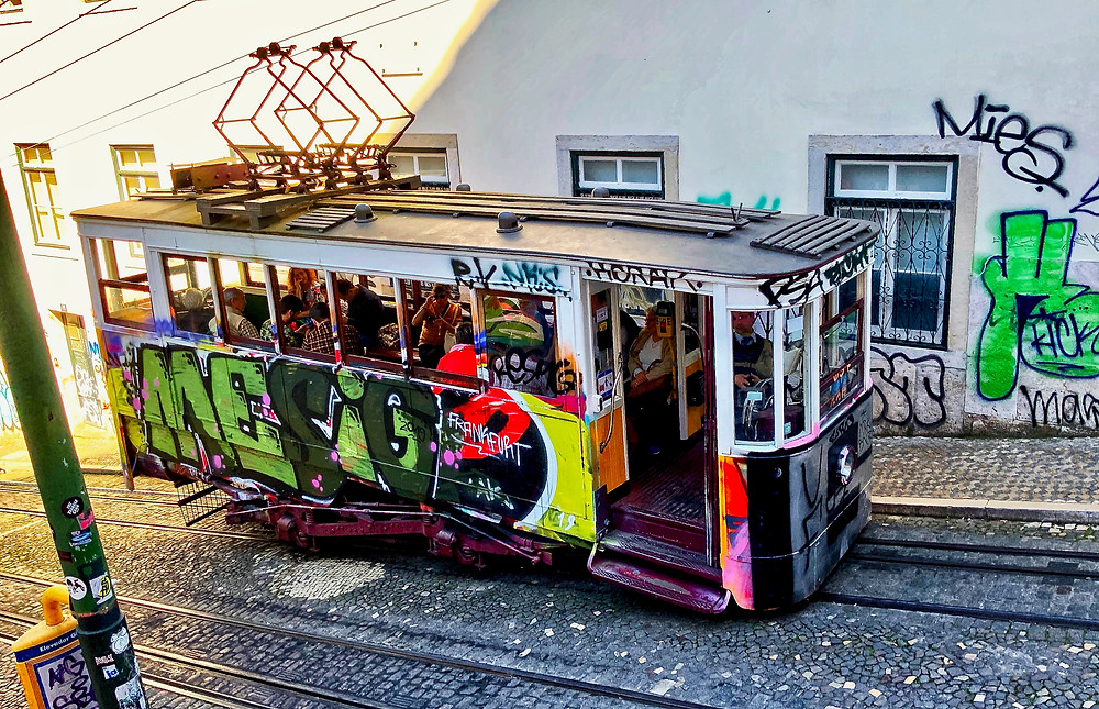 the colorful Elevador da Glória funicular.