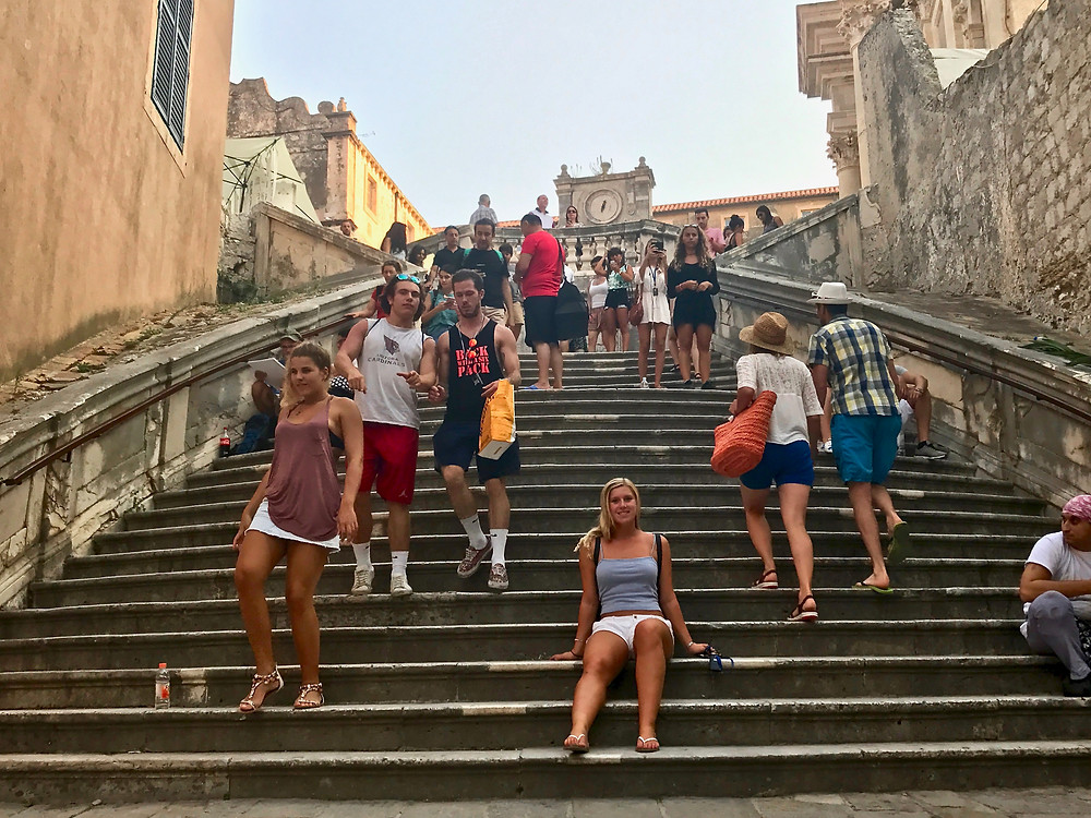my daughter on the Jesuit Staircase on a busy summer day