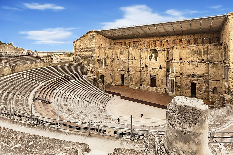 Orange Amphitheater in Provence France, with a statue of Augustus center stage lording over the scene