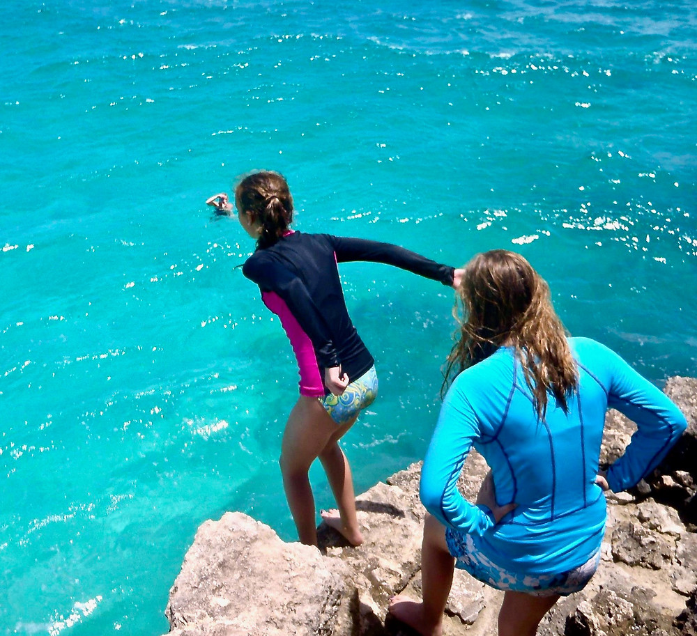 My daughter and I cliff jumping at Crane Beach in Barbados