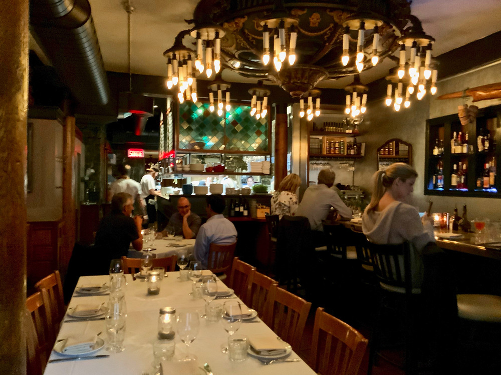 Garde Manger, with a massive period chandelier dominating the room