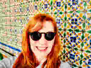 me enjoying the tile panels in the Casa de Pilatos