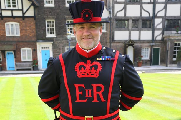 a Yeoman Warder or Beefeater about to give a tour at the Tower of London
