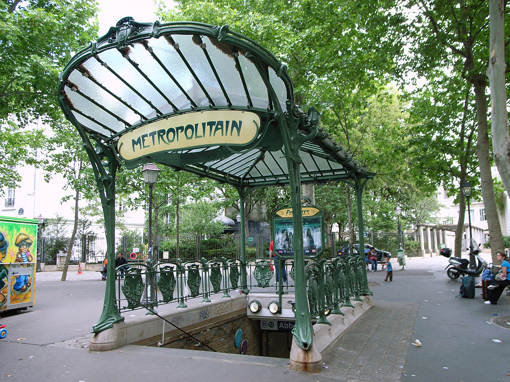 Abbesses Metro stop in the 9th arrondissement -- one of the three remaining Art Nouveau entrances in Paris