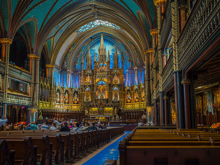 the blue-hued interior of Notre-Dame Basilica, an unmissable site in Montreal