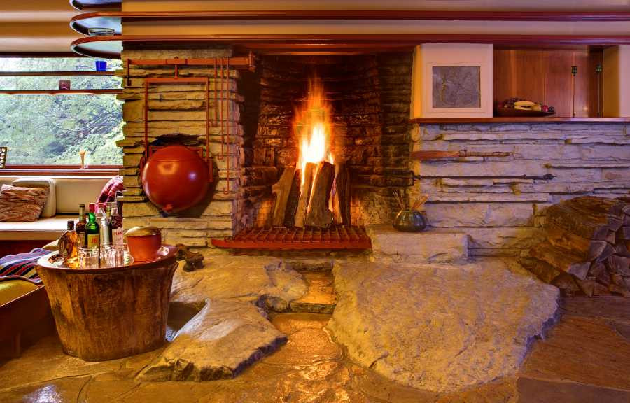 the central fireplace with a built in boulder hearth at Fallingwater