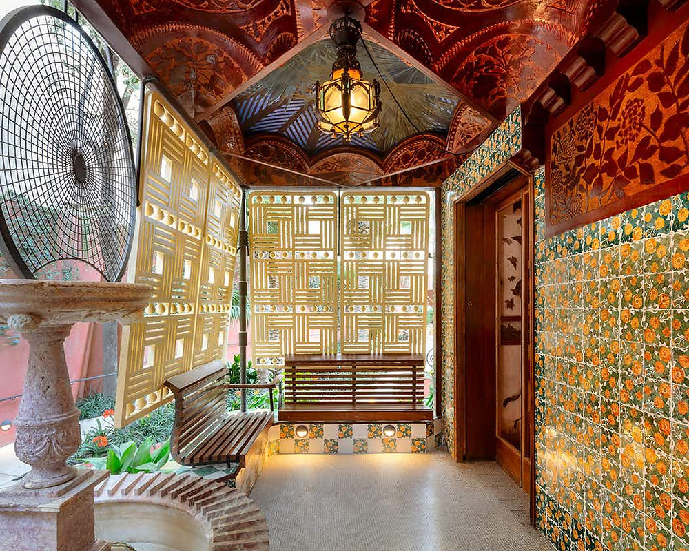 first floor terrace of Casa Vicens with marigold tiles and geometric screens