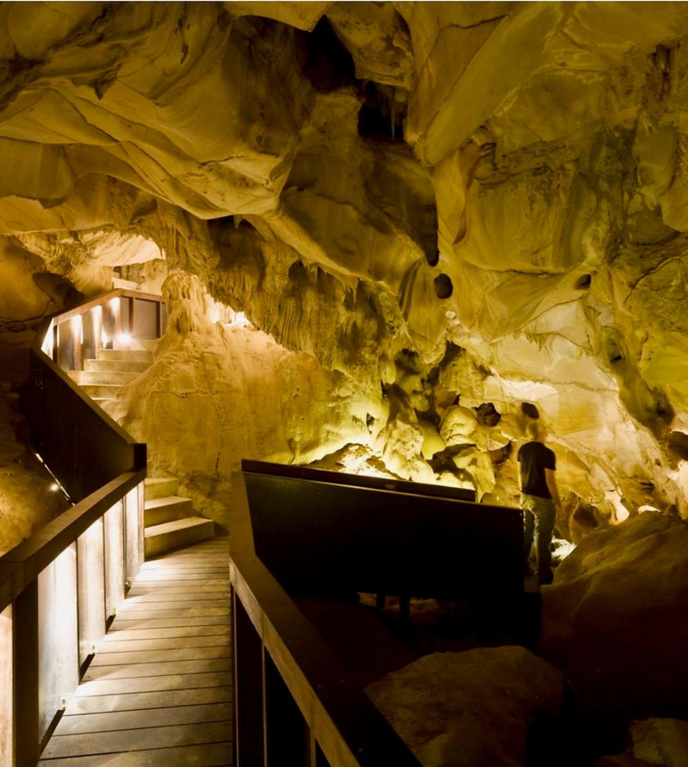a visitor path through Escoural Cave, a prehistoric site