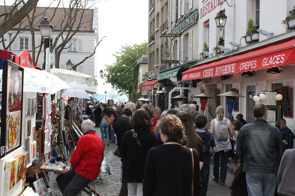 loud and crowded Place du Tertre, a hokey carnival