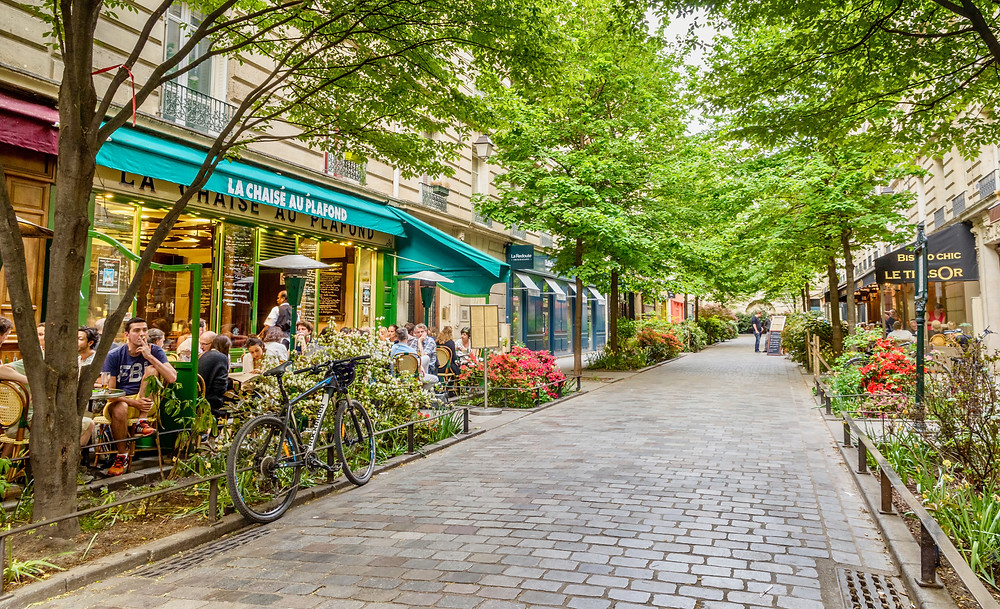 cafe lined street in the Marais