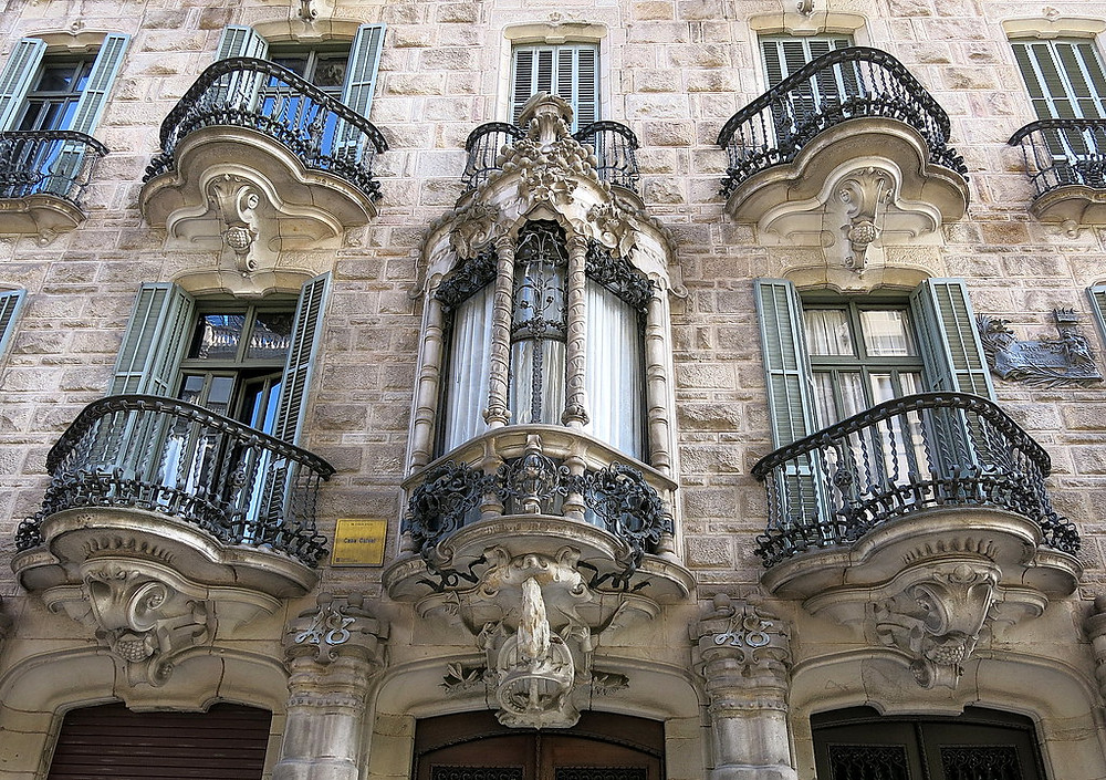 wrought iron balconies on the facade of Casa Calvet
